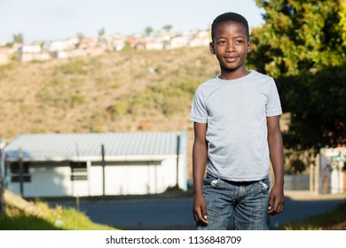 Young black boy wearing a grey t-shit
