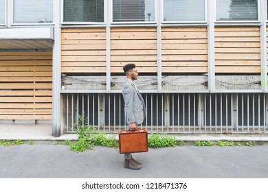 young black business man walking to work outdoor - business, working, job concept