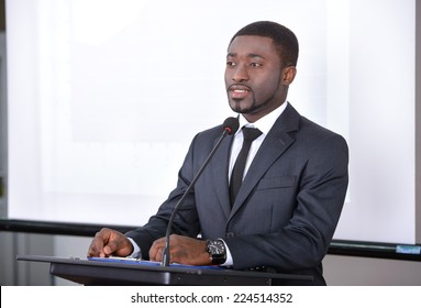 Young black businessman giving presentation to his colleagues