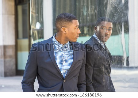 young-black-businessman-standing-by-450w