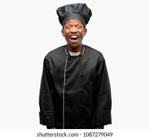 Young black cook wearing chef hat stressful, terrified in panic, shouting exasperated and frustrated. Unpleasant gesture. Annoying work drives me crazy