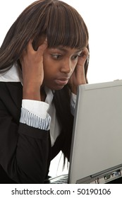 Young black female professional with hands in hair over laptop