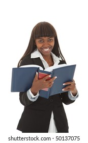 Young black female professional laughing at thick book