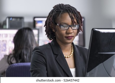 Young black female professional working at a computer in an office