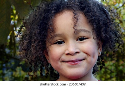 Young black girl with a beautiful smile