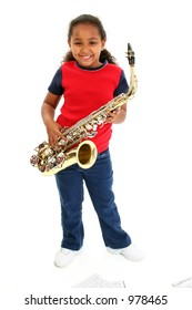 Young black girl with saxophone over white.