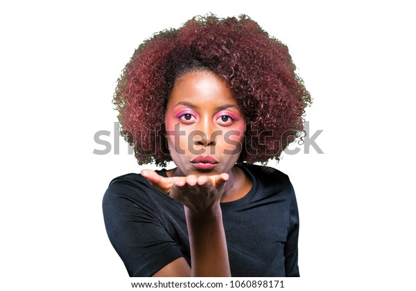 young black girl sending a kiss