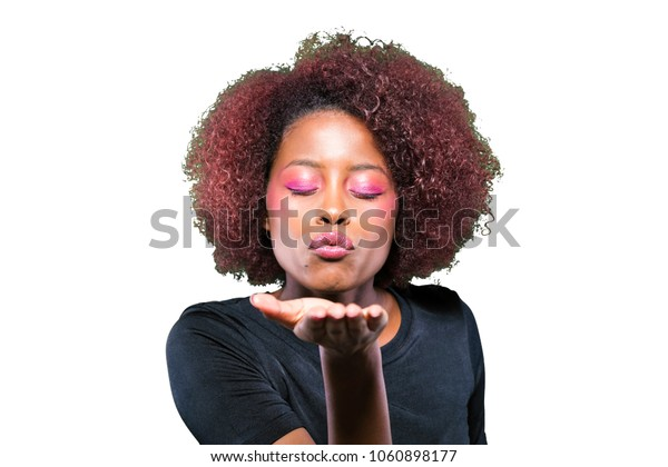 young black girl sending a kiss