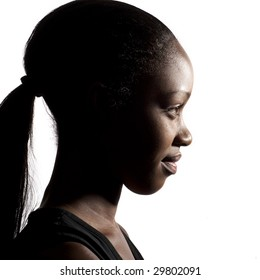 A young black girl, shot in profile