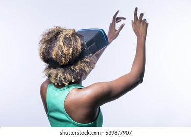 Young black girl with virtual reality glasses