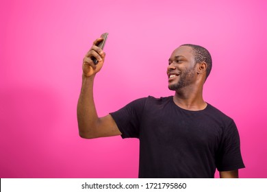 young black happy man using his smartphone to chat