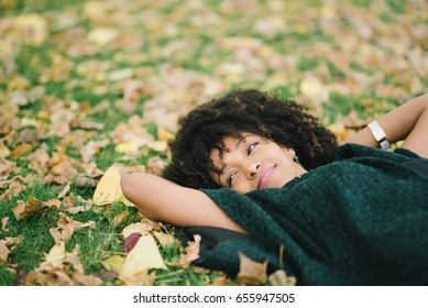 Young black happy woman relaxing in autumn. Happiness and relax concept.