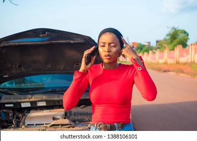young black lady feeling stressed trying to call for help when her car breaks down