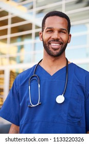 Young black male healthcare worker smiling outside, vertical