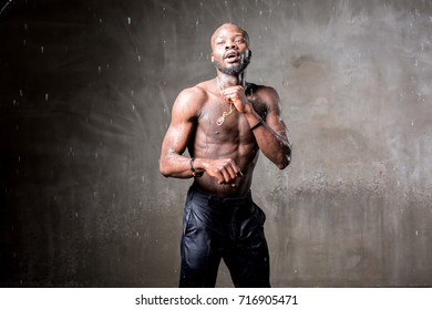 A young black man african american man trains boxing at the gym