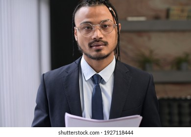 Young black man, extraordinary office employee looks into the camera with a confident look, portrait of a young leader