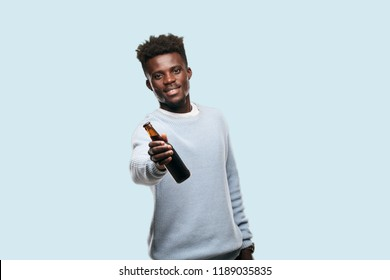 young black  man having a beer