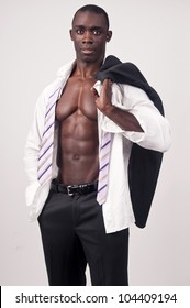 Young black man with muscular body and suit