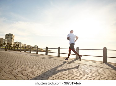 Young black man running on the Promenade.