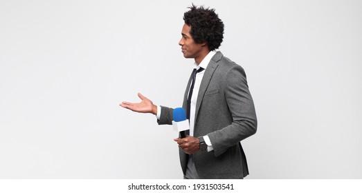 young black man as a tv presenter
