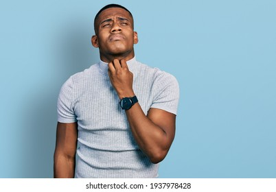 Young black man wearing casual t shirt touching painful neck, sore throat for flu, clod and infection