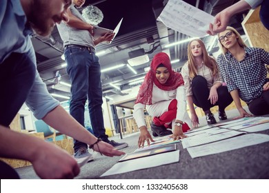 young black muslim businesswoman having meeting with her multiethnic startup business team in modern office interior,presenting new ideas on the floor