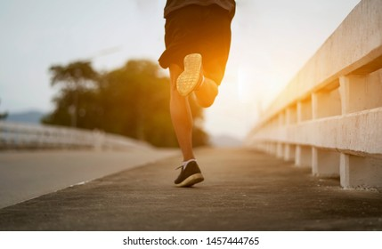 Young black runner man running on the street be exercise and workout in nature countryside road in the morning. Healthy body exercise sports concept.