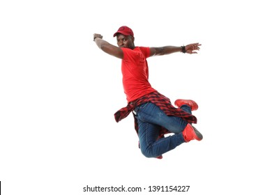Young black stylish guy in red in a jump isolated on white background.