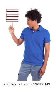 Young black teenage student men holding books, isolated on white background - African people