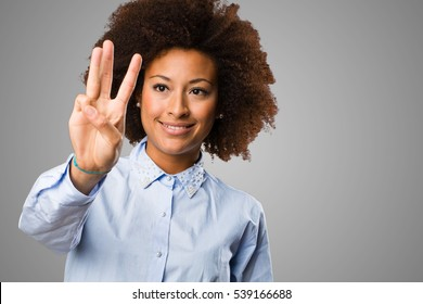 young black woman doing number three gesture