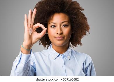 young black woman doing okay gesture