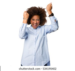 young black woman doing winner gesture