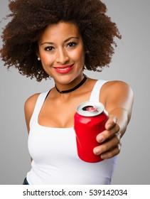 young black woman holding a coke
