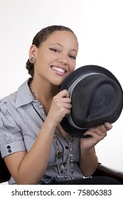 Young black woman holding hat portrait smiling