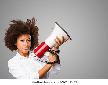 young black woman holding a megaphone