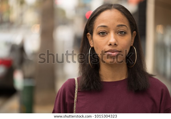 Young black woman portrait face in city