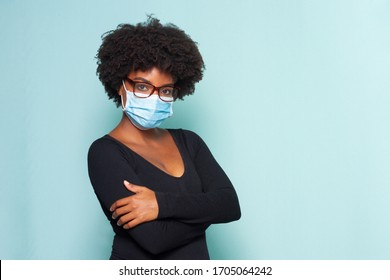 young black woman with black power hair wearing protective mask with reading glasses