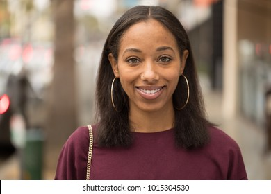 Young black woman smile happy face portrait