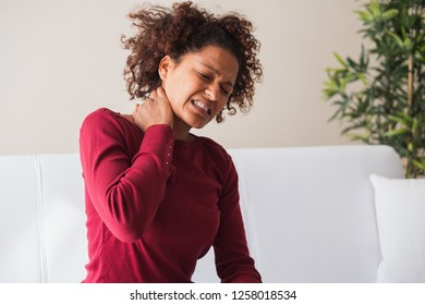 Young black woman suffer shoulder and neck pain