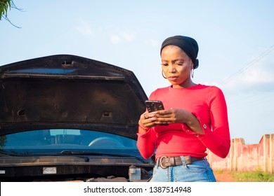 young black woman trying to get help to fix her car