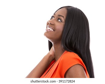 young black woman wearing bright dress on white background