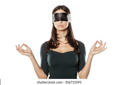young blindfolded woman in meditation pose