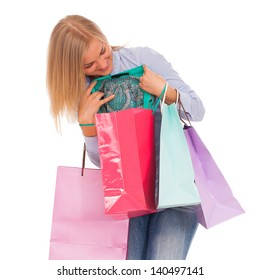 Young blond caucasian woman with shopping bags smiling over white background
