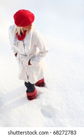 Young blond cheerful girl in the snow