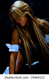 young blond dancer with white strips