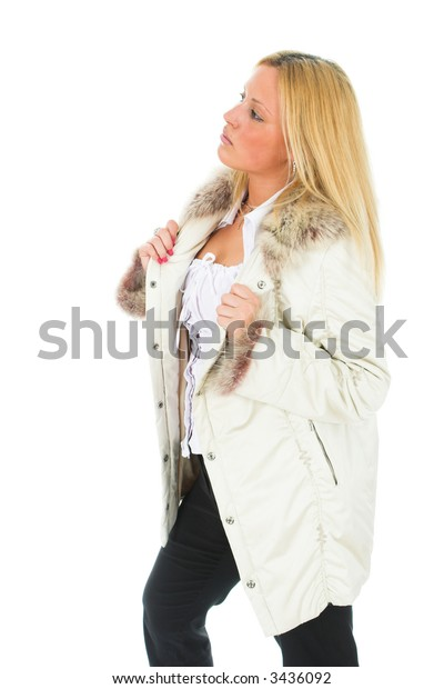 Young blond female in winter clothing, isolated on white