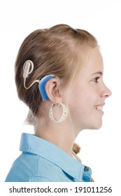 Young blond girl with cochlear implant