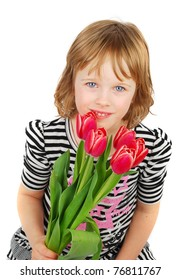 Young blond girl  sitting down and holding a bouquet of pink tulips on a white background