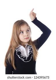 Young blond girl who is pointing a finger on... Isolated on the white