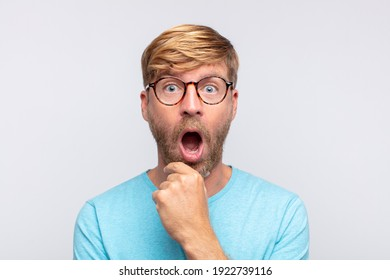 young blond man surprised or shocked